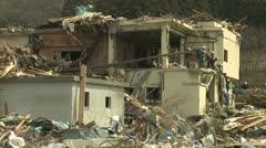 Japan Tsunami Aftermath - Rescue Crew Climb Off Destroyed Building - stock footage