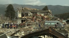 Japan Tsunami Aftermath - Rescue Crew Attend To Dead Body In Rikuzentakata City Stock Footage