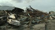 Japan Tsunami Aftermath - Destroyed Cars And Piles Of Timber In Ofunato City Stock Footage