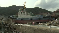 Japan Tsunami Aftermath - Large Boat Rests In Middle Of Ofunato City - stock footage
