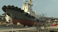 Japan Tsunami Aftermath - Large Boat Rests In Middle Of Ofunato City Stock Footage
