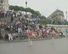 Street performers in front of the Sacre Coeur Basilica Stock Footage