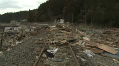 Japan Tsunami Aftermath - Debris Washed Up On Railway Tracks Stock Footage