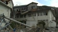 Japan Tsunami Aftermath - House Lies On Top Of Building In Onagawa City Stock Footage