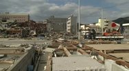 Japan Tsunami Aftermath - Japanese Flag Flies In Ruins Of Onagawa City Stock Footage