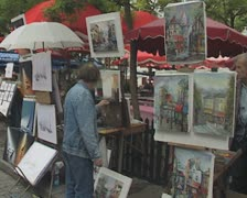 Artist painting at outdoor stall Stock Footage
