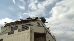 Japan Tsunami Aftermath - Car Sits On Roof Of Building In Onagawa City Stock Footage