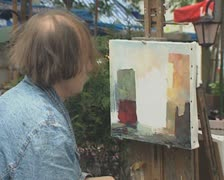 Close up of artist painting at outdoor stall Stock Footage