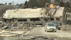 Japan Tsunami Aftermath - Destroyed Building Blocks Road In Onagawa City Stock Footage