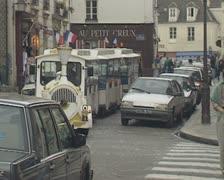 Train bus driving through street Stock Footage