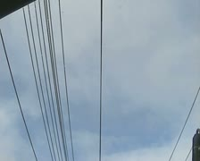 View of overhead wires from moving train Stock Footage