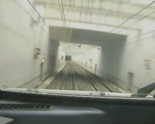 View from front of moving train going into tunnel Stock Footage