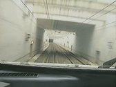 Stock Video Footage of View from front of moving train going into tunnel