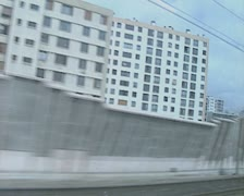 View of city through moving train window Stock Footage