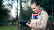 Stock Video Footage of Young happy woman with tablet computer in the park HD