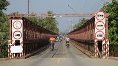 Traffic on old bridge over the Mekong river, Luang Prabang, Laos Stock Footage