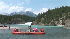 WorldClips-Bow River Raft Comes About-ws Stock Footage