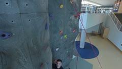 Climbing a Rock Climbing Wall(HD)c Stock Footage