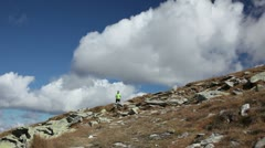 Man hiking into the mountains Stock Footage