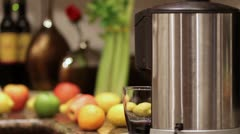 Juicer and Juice being poured - stock footage