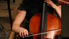 close-up view on violoncello in orchestra - stock footage