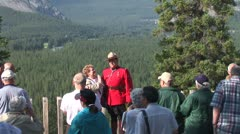 WorldClips-Mounty with Tourists-zooms Stock Footage