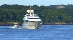Extravagant Yacht cruses canal; 1 - stock footage