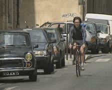 Cyclist going down quiet road Stock Footage
