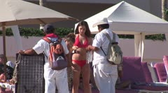 WorldClips-Beach Merchants-Girl Stock Footage