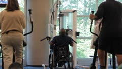 Man in wheelchair working out on exercise equipment Stock Footage