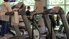 People working out on exercise equipment Stock Footage