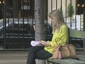 Stock Video Footage of Woman sitting outside on park bench