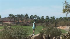 Stock Video Footage of WorldClips-Cabo Girl Golfer