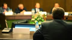 Man in business suit sit at the table on conference - stock footage