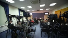 Journalists wait conference in press room Stock Footage