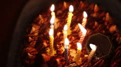 Happy Birthday cake with burning spiral candles in dark Stock Footage
