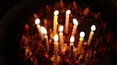 Happy Birthday cake with burning spiral candles which are then extinguished Stock Footage