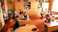 Schoolchildren sits in classroom, panoramic view at School 1349 Stock Footage