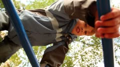 Boy climb on stairs at playground Stock Footage