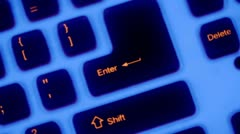 Buttons of keybord with blue backlight rotates in dark Stock Footage