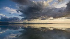 Clouds at sunset, refection in water Stock Footage