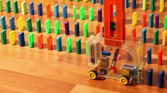 Toy machine moves and put colored domino blocks Stock Footage