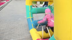 Girl walk in inflated wheel in park at autumn day at Bolotnaya square Stock Footage