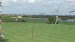 WorldClips-Cancun Practice Green Putter Stock Footage