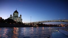 Ship sail down the river, Christ Savior Cathedral and Patriarchal Bridge at Stock Footage