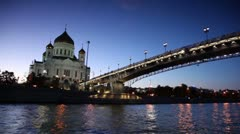 Christ Savior Cathedral and Patriarchal Bridge at evening Stock Footage