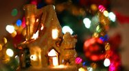 Fabulous toy house with Santa Claus near Christmas tree and colorful garlands Stock Footage