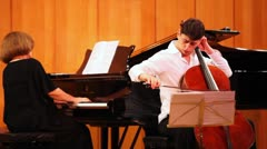 Stock Video Footage of Narek Hakhnazaryan plays cello, Gayane Hakhnazaryan plays piano