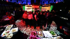 People at party near buffet table in night club Stock Footage