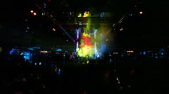 Group of guys sing and dance on stage at night club Stock Footage